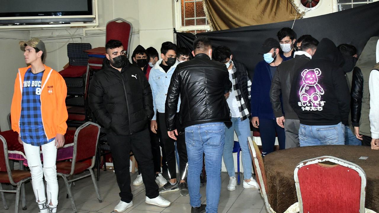 Dozens fined for gathering in cafe entered via secret passageway