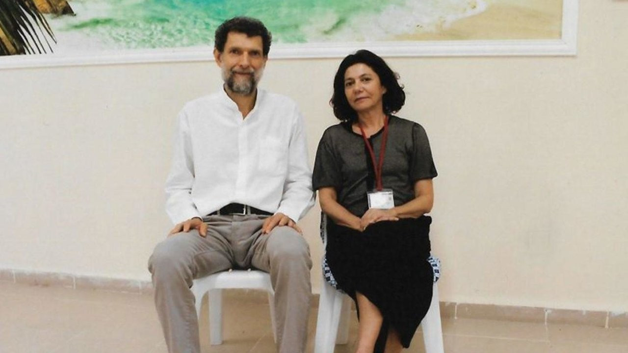 Turkish court rules to keep Osman Kavala behind bars, merges his files