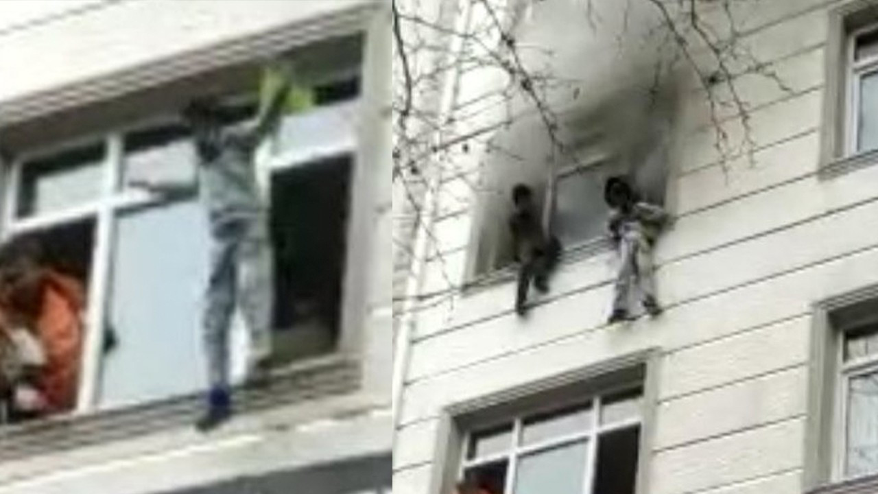 Shocking video shows moment kids were rescued from burning building