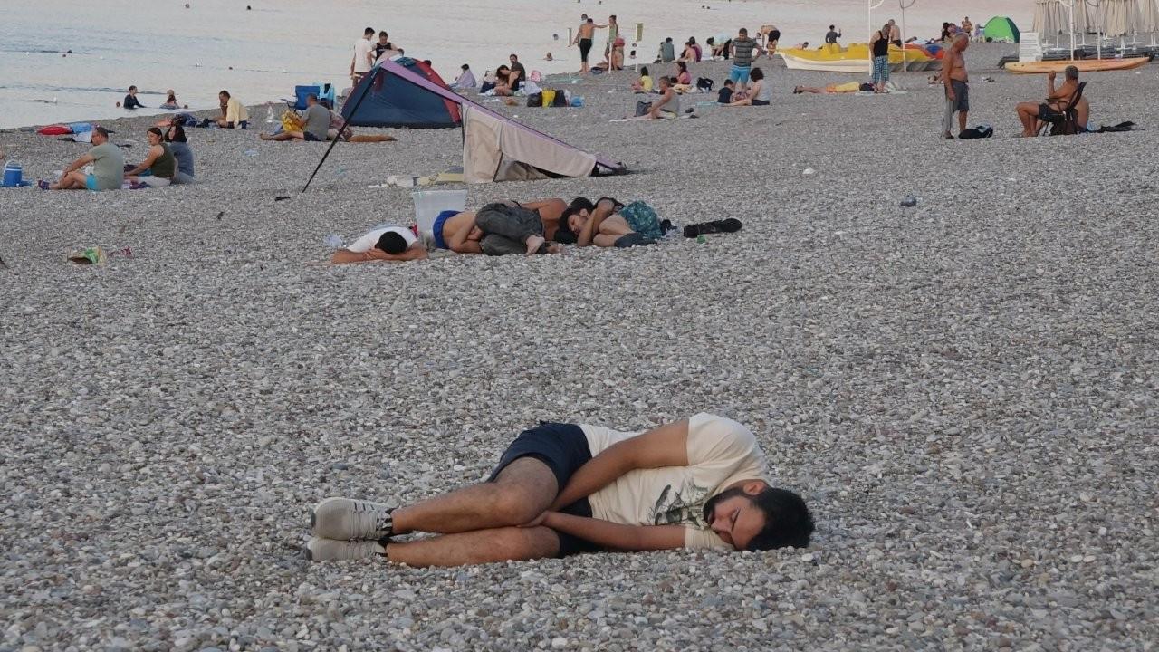 Antalya residents sleep on the beach to escape from heat, humidity