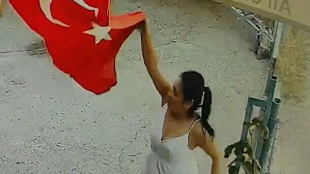 Turkish court arrests woman for throwing national flag in trash bin