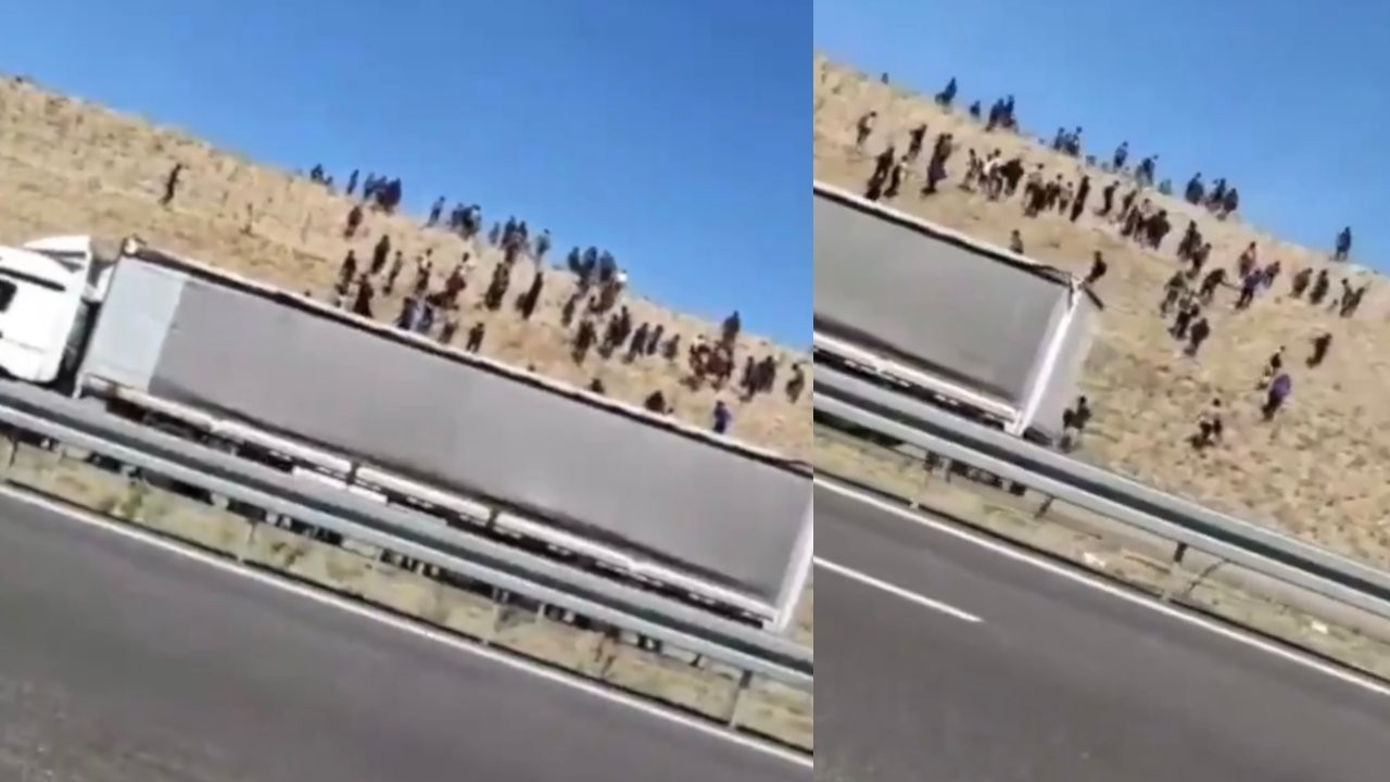 Dozens of refugees seen leaving truck on the side of the road in central Turkey