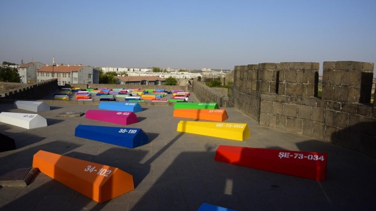 Kurdish artist's exhibition displaying colorful coffins stirs debate