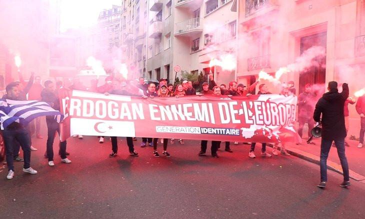 Police detain far-right demonstrators during protest against Erdoğan in Paris