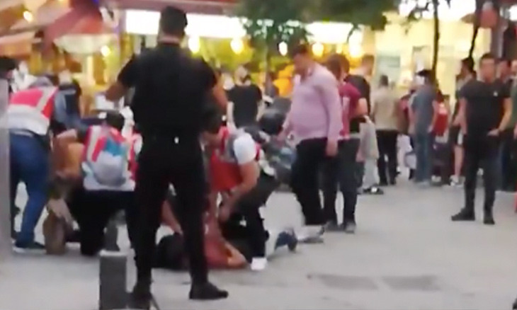 Protester tells Turkish police kneeling on his back to stop pressing: I can't breathe
