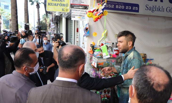I want to die because of the economy, says Turkish shop owner when asked why he is not wearing a mask